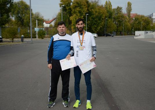 Andrei Gafita taking picture with his diplomas after finishing the competition - ASSIST Software