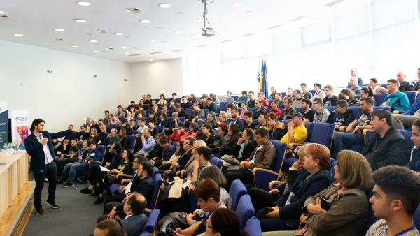 ASSIST Software representative Alexandru Boca, talking in front of high school students at the National Olympiad in Informatics 2019
